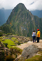 People tour the ruins of Machu Picchu near Aguas Calientes, Peru, on May 18, 2008. Machu Picchu, often referred to as the ?Lost City of the Incas,? is a pre-Colombian Inca site situated on a mountain ridge above the Urubamba Valley. Visits to Peru?s top tourist destination have more than doubled in the last decade to 800,000 people.