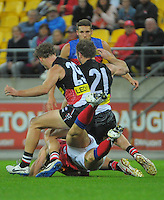 Jonathan Brown dives on the ball during the Australian Rules Football ANZAC Day match between St Kilda Saints and Brisbane Lions at Westpac Stadium, Wellington, New Zealand on Friday, 25 April 2014. Photo: Dave Lintott / lintottphoto.co.nz