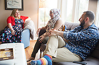 """SEATTLE, WA-APRIL 17, 2017: Amanda Saab, center, along with her husband Hussein Saab, joke with Stefanie Fox, left, before they co-host a """"dinner with your Muslim neighbor"""" at the home of Stefanie and Nason (cq) Fox in Seattle, WA on April 17th 2017. (Photo by Meryl Schenker/For The Washington Post)"""
