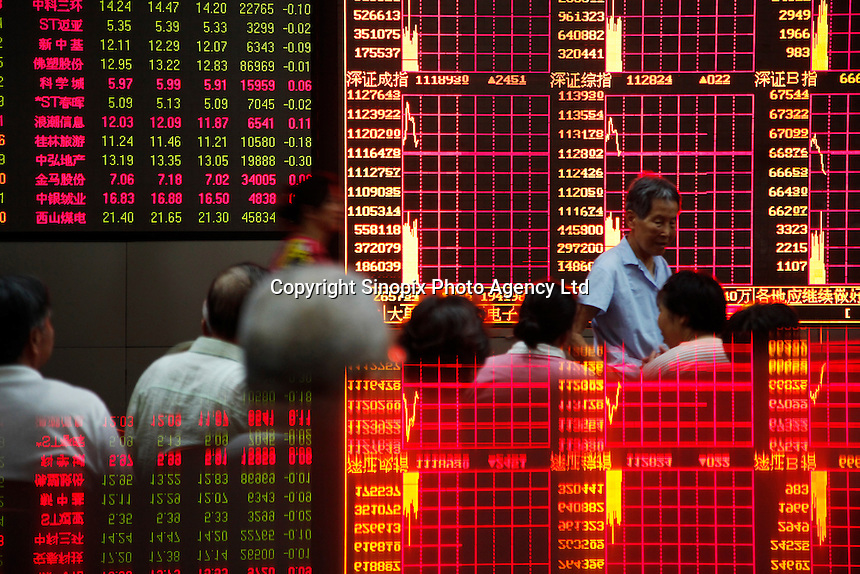 A stock display is reflected on a tabletop while investors monitor and trade stocks at a securities exchange house in Shanghai, China. The Shanghai Stock Exchange (SSE) is one of the three stock exchanges operating independently in the People's Republic of China, the other two are the Shenzhen Stock Exchange and the Hong Kong Stock Exchange. It is the world's sixth largest stock market by market capitalization at US$2.4 trillion as of Aug 2010..17 Aug 2010