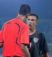 Dominick Sarle speaks with the referee.  Spain defeated the U.S. Under-17 Men National Team  2-1 at Sani Abacha Stadium in Kano, Nigeria on October 26, 2009.