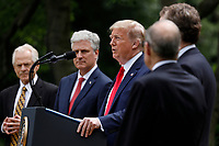 United States President Donald J. Trump delivers remarks on China in the Rose Garden at the White House in Washington, DC on May 29, 2020. Pictured from left to right; Peter Navarro, Director of Trade and Industrial Policy and Director of the White House National Trade Council; US National Security Advisor Robert C. O'Brien; and the president.<br /> Credit: Yuri Gripas / Pool via CNP/AdMedia