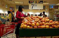A lady buys apples at a Wal-mart superstore in the center of Kunming, capital of Yunnan Province, China. An Introduction to Wal-Mart. In 1996, Wal-Mart entered the Chinese market nowadays operate 45 units in 21 cities across the mainland. The American retailer is very popular and is responsible for the closure of many local traditional markets..08 Jul 2005