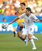 Clint Dempsey (8) of USA and Miranda (left) of Brazil battle for the ball. Brazil defeated USA 3-0 during the FIFA Confederations Cup at Loftus Versfeld Stadium in Tshwane/Pretoria, South Africa on June 18, 2009.