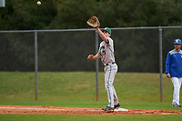 Dartmouth Big Green first baseman Oliver Campbell (27) stretches for a throw during a game against the Indiana State Sycamores on February 21, 2020 at North Charlotte Regional Park in Port Charlotte, Florida.  Indiana State defeated Dartmouth 1-0.  (Mike Janes/Four Seam Images)