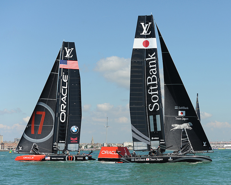 SoftBank Team Japan, JULY 23, 2016 - Sailing: SoftBank Team Japan rounds the mark ahead of Oracle Team USA during day one of the Louis Vuitton America's Cup World Series racing, Portsmouth, United Kingdom. (Photo by Rob Munro/Stewart Communications)