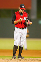Relief pitcher Nick McCully #12 of the Kannapolis Intimidators toes the rubber during the South Atlantic League game against the Lakewood BlueClaws at Fieldcrest Cannon Stadium on July 16, 2011 in Kannapolis, North Carolina.  The Intimidators defeated the BlueClaws 5-3.   (Brian Westerholt / Four Seam Images)