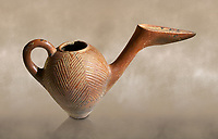 Bronze Age Anatolian terra cotta side spouted pitcher with bill shaped end - 19th to 17th century BC - Kültepe Kanesh - Museum of Anatolian Civilisations, Ankara, Turkey.  Against a warn art background.