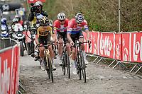 Kasper Asgreen (DEN/Deceuninck - Quick Step), Mathieu Van der Poel (NED/Alpecin-Fenix) & Wout van Aert (BEL/Jumbo-Visma) up the Oude Kwaremont<br /> <br /> 105th Ronde van Vlaanderen 2021 (MEN1.UWT)<br /> <br /> 1 day race from Antwerp to Oudenaarde (BEL/264km) <br /> <br /> ©kramon