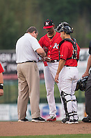 Kannapolis Intimidators trainer Joe Geck attends to a cut on the finger of starting pitcher Luis Martinez (29) as catcher Seby Zavala (21) looks on during the game against the Lakewood BlueClaws at Kannapolis Intimidators Stadium on May 9, 2016 in Kannapolis, North Carolina.  The BlueClaws defeated the Intimidators 4-1.  (Brian Westerholt/Four Seam Images)