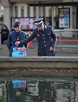 Pictured: Cadets deposit poppies in the fountain Friday 11 November 2016<br />
