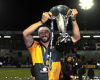 Tom Wood of Northampton Saints celebrates with the Amlin Challenge Cup trophy at Cardiff Arms Park on Friday 23rd May 2014 (Photo by Rob Munro)