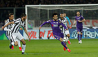 Calcio, Coppa Italia: semifinale di ritorno Fiorentina vs Juventus. Firenze, stadio Artemio Franchi, 7 aprile 2015. <br /> Fiorentina's Mohamed Salah, right, is challenged by Juventus' Claudio Marchisio, left, and Giorgio Chiellini during the Italian Cup semifinal second leg football match between Fiorentina and Juventus at Florence's Artemio Franchi stadium, 7 April 2015.<br /> UPDATE IMAGES PRESS/Isabella Bonotto