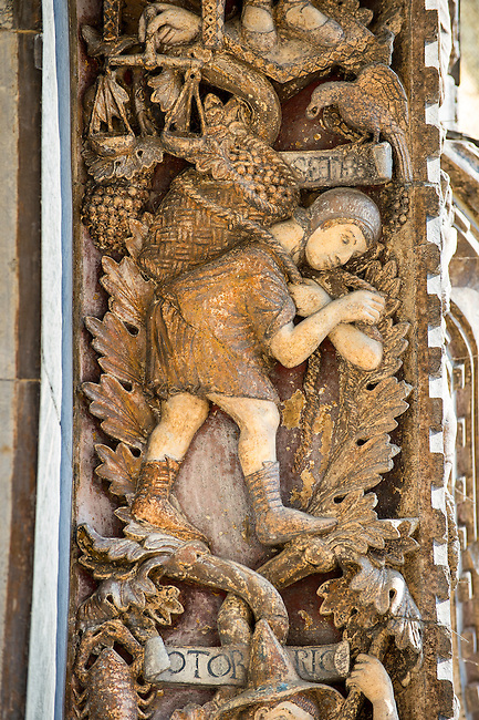 13th century Medieval Romanesque Sculptures from the introdos of the second arch of the facade of St Mark's Basilica, Venice, depicting October from the Months of the Zodiac .