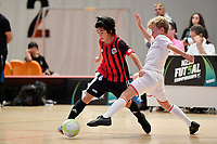 Yume Endo of Selwyn College and Liam West of Hamilton Boys' High School battle for the ball during the Futsal NZ Secondary Schools Junior Boys Final between Hamilton Boys High School and Selwyn College at ASB Sports Centre, Wellington on 26 March 2021.<br /> Copyright photo: Masanori Udagawa /  www.photosport.nz