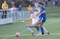 NWA Democrat-Gazette/J.T. WAMPLER Arkansas' Ashleigh Ellenwood collides with a University of Missouri-Kansas City player Sunday Sept. 13, 2015. Ellenwood was injured on the play and was removed from the game.