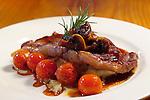 Juicy Porterhouse Steak garnished with mushrooms,cherry tomato's,Basil