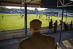 Lancaster City 0 FC Halifax Town 3, 15/10/2011, Giant Axe, FA Cup Third Qualifying Round. An elderly man in a flat cap watching the action from the terraces behind the goal during the second half as Lancaster City (in blue) play against FC Halifax Town in an FA Cup third qualifying round match at Giant Axe stadium. The visitors, who play two leagues above their hosts in the English football pyramid, won the ties by three goals to nil, watched by a crowd of 646 spectators. Lancaster City were celebrating their centenary in 2011, although there was a dispute over the exact founding date over the club known as Dolly Blue. Photo by Colin McPherson.