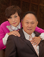 Cecil Chao Sze-Tsung and his daughter Gigi pose for a portrait at the company HQ, Cheuk Nang Holdings in Hong Kong on Wednesday, November 28, 2012.  Cecil caused controversy by suggesting he would offer 500 million HK$ to a male suitor for his daughter, allegedly a lesbian.     Photo credit:   Ira Chaplain / Sinopix