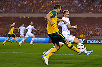 MELBOURNE, AUSTRALIA - JUNE 7: Brett Emerton of the Socceroos and Slobodan Rajovic of Serbia compete fot the ball during an international friendly match between the Qantas Australian Socceroos and Serbia at Etihad Stadium on June 7, 2011 in Melbourne, Australia. Photo by Sydney Low / AsteriskImages.com