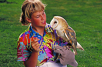 CAUCASIAN GIRL WITH OWL AT THE LINDSAY MUSEUM. CAUCASIAN GIRL WITH OWL. WALNUT CREEK CALIFORNIA USA.