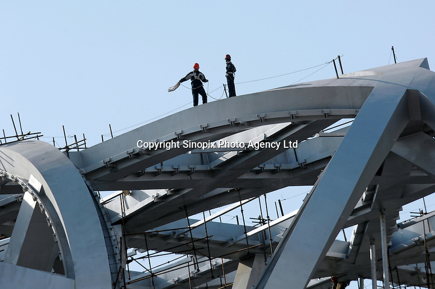 "Work is carried out on the new Olympic Stadium in Beijing, China. The structure locally known as the ""bird's nest"" and will be at the heart of track and field competitions and the opening and closing ceremonies for the  2008 Beijing Olympics..02 May 2007"