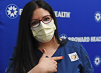 FORT LAUDERDALE, FL - DECEMBER 23: Lissette Gutierrez, RN, assistant nurse manager in progressive care unit, Broward Health Imperial Point, shows off her shot sticker after receiving a shot of the Moderna COVID-19 vaccine as Broward Health begins Vaccinating frontline Healthcare caregivers with the Moderna COVID-19 vaccine at Broward Health Medical Center Imperial Point on December 23, 2020 in Fort Lauderdale, Florida. <br /> CAP/MPI04<br /> ©MPI04/Capital Pictures
