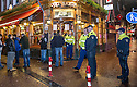 Police stand guard at the Old Sailor Pub in the red light district of Amsterdam after it was attacked by Ajax fans.