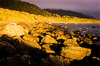 Intense sunset at Martins Bay on Hollyford Track - Fiordland NP, Southland, New Zealand