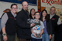 Aaron Burmeister recieves the Northern Air Cargo Herbie Nayokpuk award from Dave Karp, Sami Glascott and Cheryl Johnson of NAC as well as Michelle Bonham (Herbies grand daughter) and Bethany Thomas (Herbie's great-granddaughter) at the finishers banquet in Nome on Sunday  March 22, 2015 during Iditarod 2015.  <br /> <br /> (C) Jeff Schultz/SchultzPhoto.com - ALL RIGHTS RESERVED<br />  DUPLICATION  PROHIBITED  WITHOUT  PERMISSION