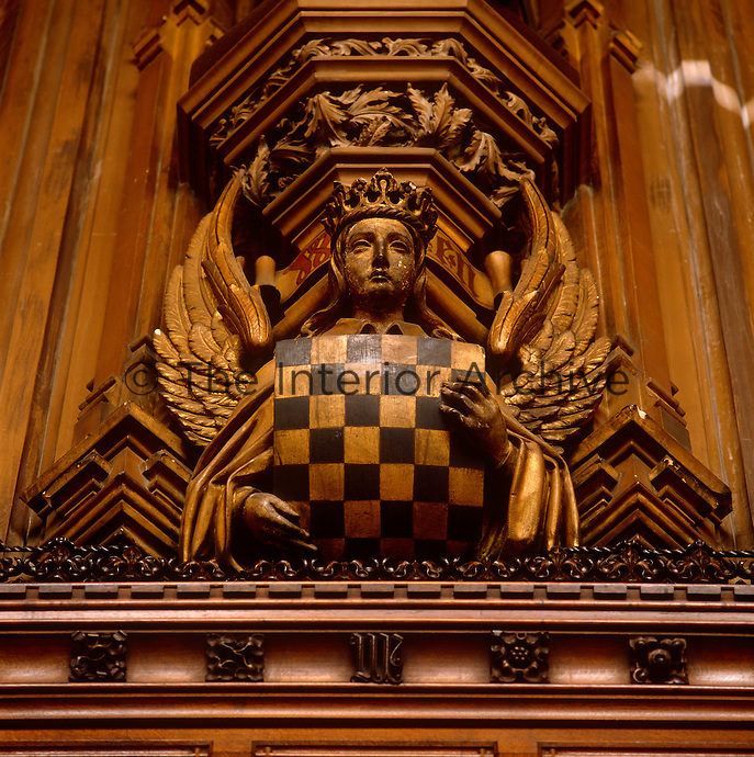 One of the carved angels between the windows of the Chamber, which is situated beneath the Magna Carta barons