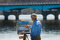 Bill Westerman paints his interpretation of a bridge crossing Hoover Reservoir