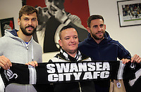 Pictured: Fernando Llorente and Angel Rangel Tuesday 29 November 2016<br />Re: Soup kitchen for homeless people organised by Swansea City FC and Woolwich at the Liberty Stadium, Wales, UK