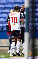 Bolton Wanderers' Nathan Delfouneso (right) celebrates with his team mate Antoni Sarcevic after scoring his sides first goal <br /> <br /> Photographer Andrew Kearns/CameraSport<br /> <br /> The EFL Sky Bet League Two - Bolton Wanderers v Oldham Athletic - Saturday 17th October 2020 - University of Bolton Stadium - Bolton<br /> <br /> World Copyright © 2020 CameraSport. All rights reserved. 43 Linden Ave. Countesthorpe. Leicester. England. LE8 5PG - Tel: +44 (0) 116 277 4147 - admin@camerasport.com - www.camerasport.com