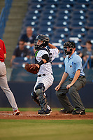 Tampa Yankees catcher Sharif Othman (62) throws down to third base as home plate umpire Tyler Jones looks on during a game against the Palm Beach Cardinals on July 25, 2017 at George M. Steinbrenner Field in Tampa, Florida.  Tampa defeated Palm beach 7-6.  (Mike Janes/Four Seam Images)