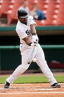 Birmingham Barons first baseman Corey Smith makes contact with the baseball in game action versus the Chattanooga Lookouts at Hoover Metropolitan Stadium in Birmingham, AL, Sunday, August 20, 2006.