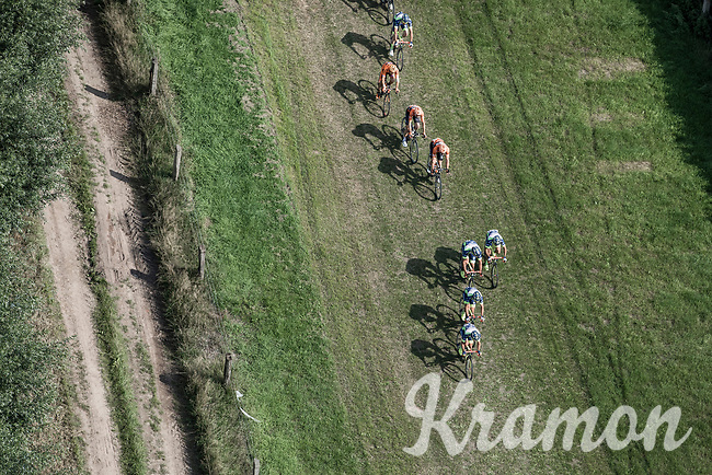 """Team Wanty Group Gobert takes the lead over a grass covered off-road section. <br /> <br /> Antwerp Port Epic 2018 (formerly """"Schaal Sels"""")<br /> One Day Race: Antwerp > Antwerp (207km of which 32km are cobbles & 30km is gravel/off-road!)"""