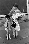 Preteen young girl in Drum Majorettes costume with her mother who is eating a take away fish and chip meal out of a newspaper. Byker, Newcastle upon Tyne, Tyne and Wear, England 1973