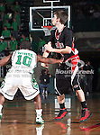 North Texas Mean Green guard Josh White (10) defends Arkansas State Red Wolves guard Adam Sterrenberg (10) during the NCAA  basketball game between the Arkansas State Red Wolves and the University of North Texas Mean Green at the North Texas Coliseum,the Super Pit, in Denton, Texas. UNT defeated Arkansas State 83 to 64..