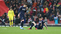 Dejection for West Ham United's Aaron Cresswell and Declan Rice at the end of the game<br /> <br /> Photographer Rob Newell/CameraSport<br /> <br /> The Premier League - Arsenal v West Ham United - Saturday 7th March 2020 - The Emirates Stadium - London<br /> <br /> World Copyright © 2020 CameraSport. All rights reserved. 43 Linden Ave. Countesthorpe. Leicester. England. LE8 5PG - Tel: +44 (0) 116 277 4147 - admin@camerasport.com - www.camerasport.com