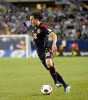 Mexico's Andres Guardado makes a move with the ball.  Mexico defeated Costa Rica 4-1 at the 2011 CONCACAF Gold Cup at Soldier Field in Chicago, IL on June 12, 2011.