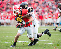 The Georgia Bulldogs beat the App State Mountaineers 45-6 in their homecoming game.  After a close first half, UGA scored 31 unanswered points in the second half.  Georgia Bulldogs wide receiver Michael Erdman (6), Appalachian State Mountaineers defensive back Doug Middleton (21)