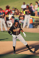 Rosell Herrera #7 of the Modesto Nuts leads off of first base during a game against the High Desert Mavericks at Heritage Field on June 29, 2014 in Adelanto, California. High Desert defeated Modesto, 6-1. (Larry Goren/Four Seam Images)