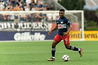 FOXBOROUGH, MA - AUGUST 18: Wilfrid Kaptoum #5 of New England Revolution brings the ball forward during a game between D.C. United and New England Revolution at Gillette Stadium on August 18, 2021 in Foxborough, Massachusetts.