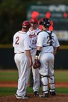 Ball State Cardinals head coach Rich Maloney (2) talks with pitcher Trevor Henderson (19) and catcher Jarett Rindfleisch (25) during a game against the Maine Black Bears on March 3, 2015 at North Charlotte Regional Park in Port Charlotte, Florida.  Ball State defeated Maine 8-7.  (Mike Janes/Four Seam Images)