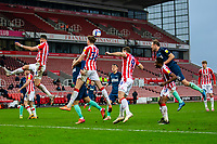 20th March 2021; Bet365 Stadium, Stoke, Staffordshire, England; English Football League Championship Football, Stoke City versus Derby County; Harry Souttar of Stoke City heads the ball clear