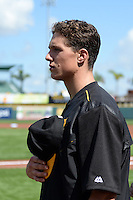 Pittsburgh Pirates pitcher Tyler Glasnow (77) during the national anthem before the Black & Gold intrasquad game on March 2, 2015 at McKechnie Field in Bradenton, Florida.  (Mike Janes/Four Seam Images)