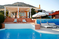 relaxing deck chairs round the pool