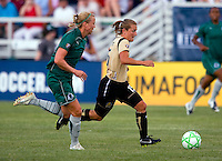 Saint Louis Athletica defender Sara Larsson (4) and FC Gold Pride forward Tiffeny Milbrett (15) during a WPS match at Anheuser-Busch Soccer Park, in St. Louis, MO, July 26, 2009.  The match ended in a 1-1 tie.