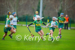 Kerry's Patrice Diggins in possession despite the attention from Meath's Aoife Maguire, Leah Dennehy and Megan Tynne in the Camogie Intermediate Championship